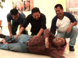 Mexican Journalist David Cilia (center) practices first aid with colleagues during a training course just outside Mexico City